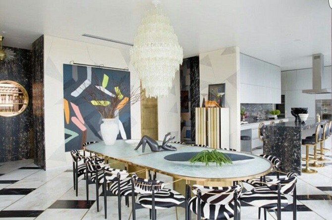 A fantastic dining room with loads of marble and gorgeous zebra upholstered chairs dining room decorating ideas Dining room decorating ideas by Kelly Wearstler Dining room decorating ideas by Kelly Wearstler 1
