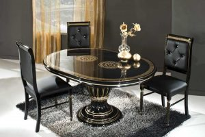 dining room Dark Dining Rooms: The Right Choice black oval table and black chairs on the fur rug 300x200